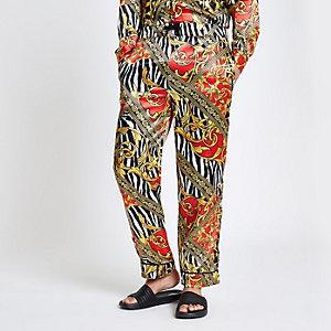 Geel geblaseerde broek met zebraprint