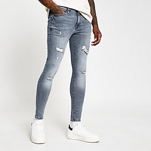 Blue Ollie spray on distressed skinny jeans