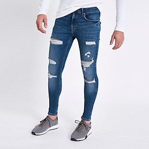 Mid blue ripped super skinny spray on jeans