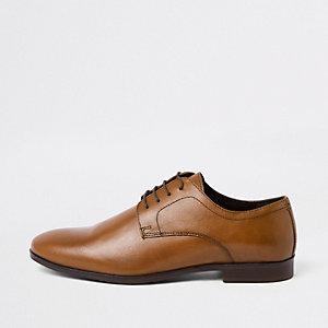 Chaussures en cuir marron à lacets avec bout rond