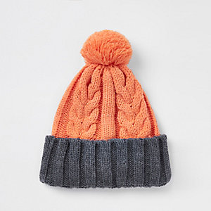 Orange cable knit bobble beanie hat