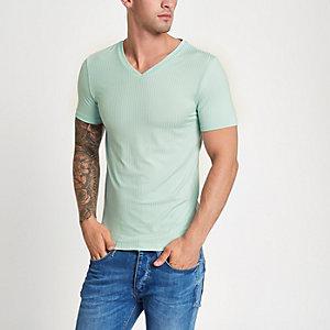 T-shirt ajusté vert côtelé à col en V