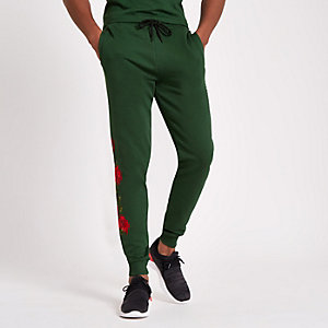 Criminal Damage green rose embroidered jogger