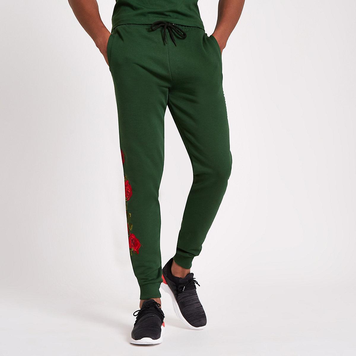 Criminal Damage green rose embroidered jogger