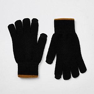 Zwarte gebreide handschoenen met gestreepte boorden