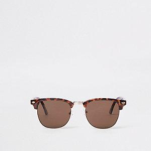 Bruine retro zonnebril met gevlekt montuur