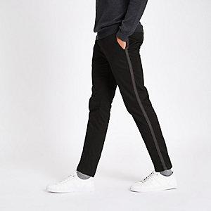 Zwarte skinny-fit broek met bies opzij