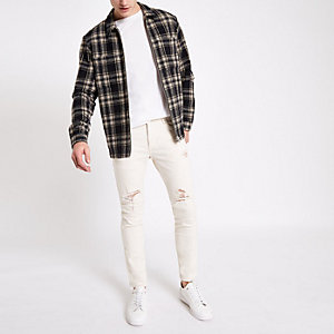 White skinny fit taped ripped jeans
