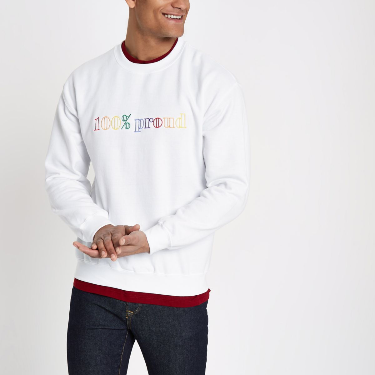 White '100% proud' pride sweatshirt