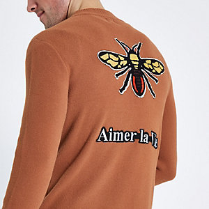 Blouson rouille avec motif abeille brodé dans le dos