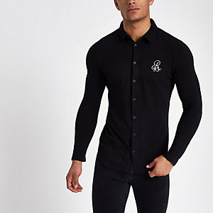 Chemise ajustée en piqué noire à manches longues