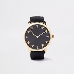 Zwart horloge met goudkleurig bandje