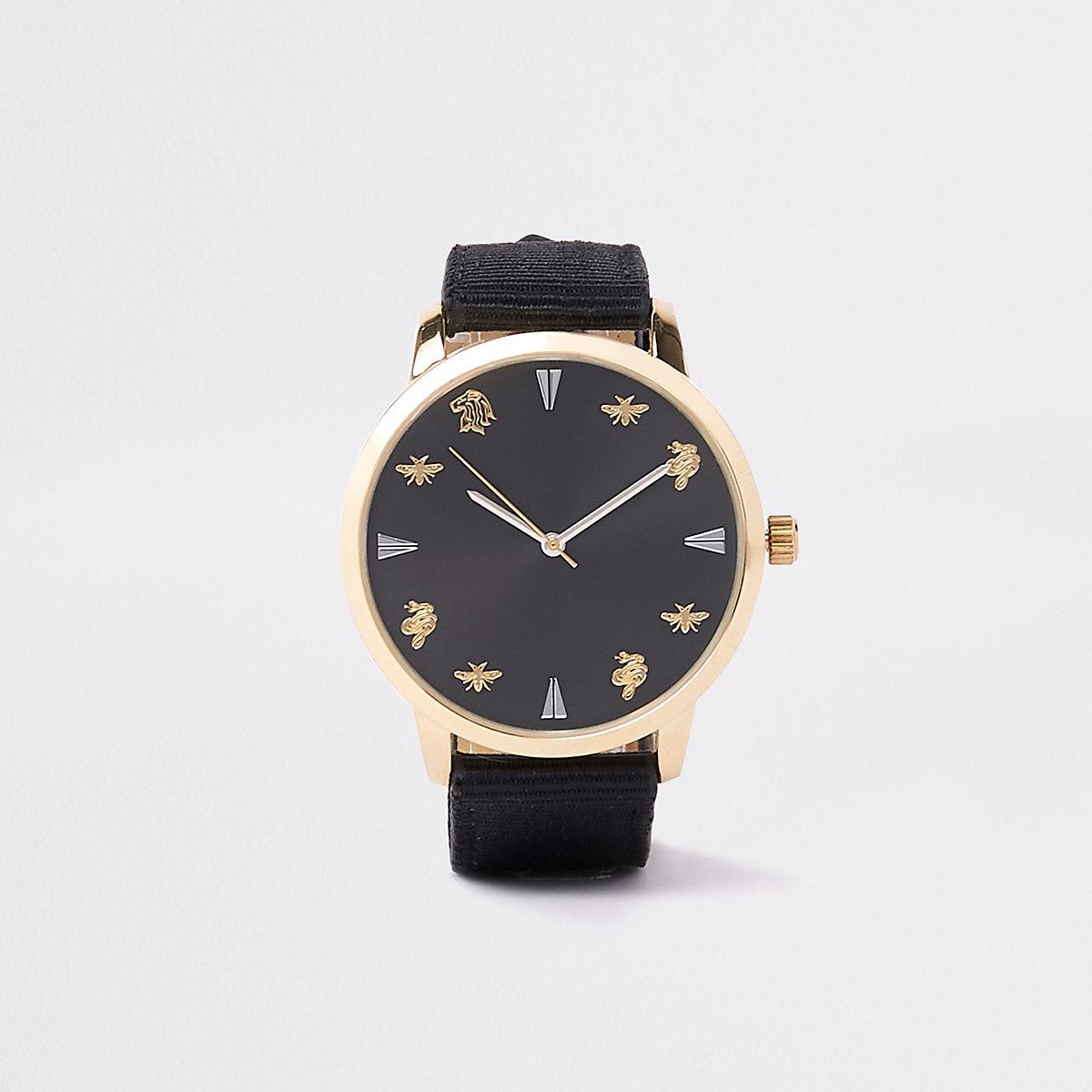 Montre dorée à bracelet en tissu noir