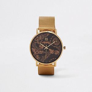 Goudkleurig horloge met mesh bandje en luipaardprint