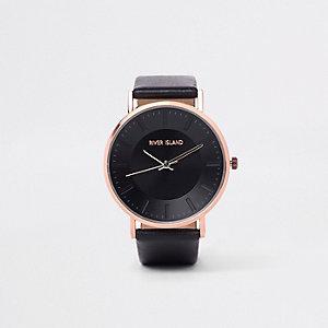 Montre noire à détails bronze