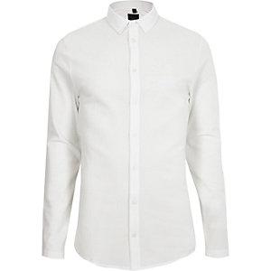 Chemise texturée blanche à manches longues et boutons