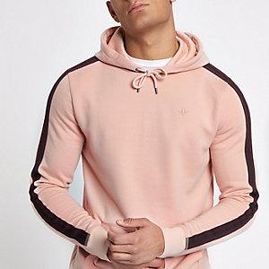 Roze slim-fit hoodie met bies opzij