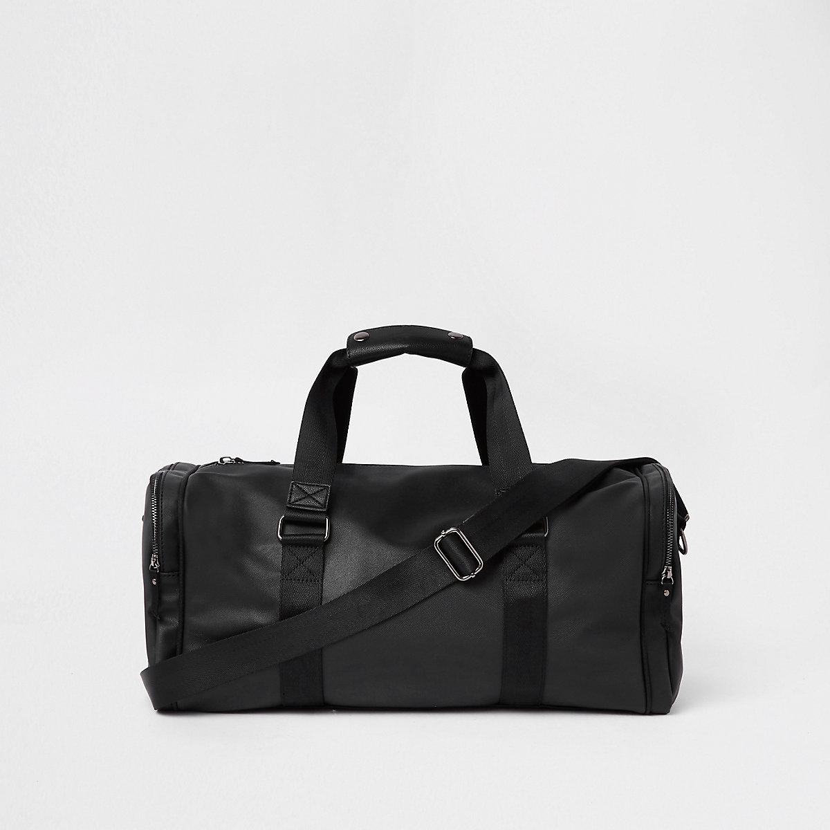 Schwarze Reisetasche aus Lederimitat