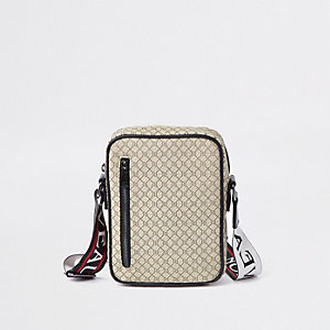 Ecru RI monogram cross body flight bag