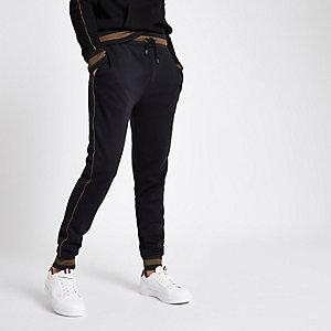 Pantalon de jogging slim noir passepoilé