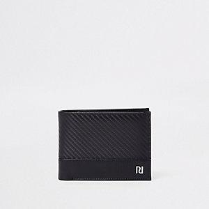 Portefeuille noir à texture contrastante
