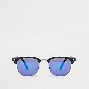 Zwarte retro zonnebril met half montuur en blauw getinte glazen