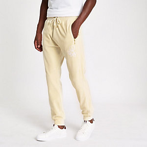Ecru slim fit embroidered joggers