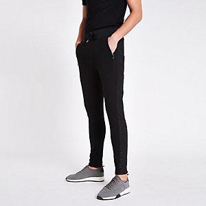 Pantalon de jogging slim noir avec empiècements à carreaux