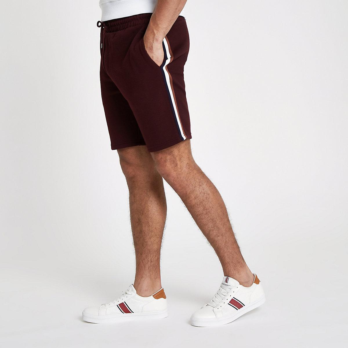 Burgundy side tape slim fit shorts