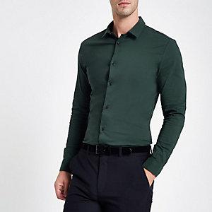 Donkergroen aansluitend overhemd