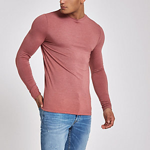 Lichtroze aansluitend T-shirt met lange mouwen