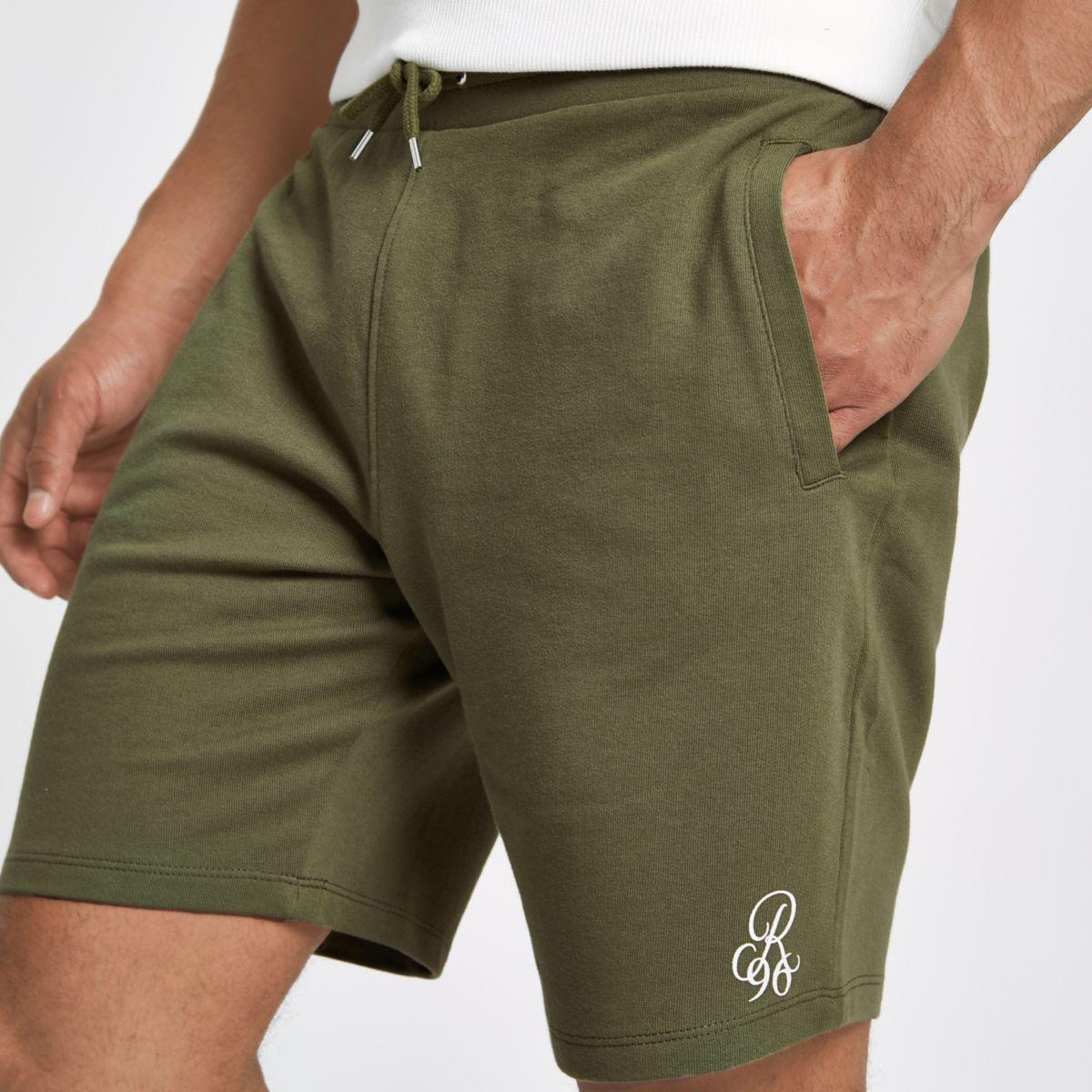 Khaki green embroidered slim fit shorts