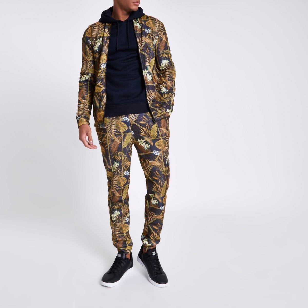 Pantalon de jogging ajusté motif chaîne et palmier noir