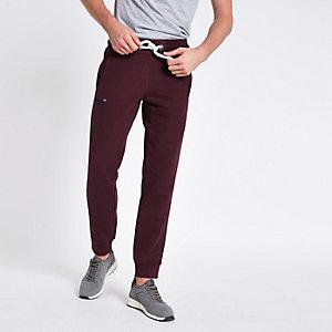 Superdry – Pantalon de jogging rouge foncé resserré aux chevilles