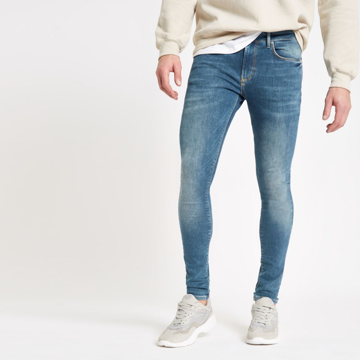 Mid blue spray on Ollie super skinny jeans