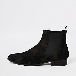 Zwarte suède chelsea boots met ster in reliëf
