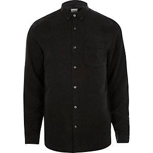 Zwart overhemd met lange mouwen en knopen