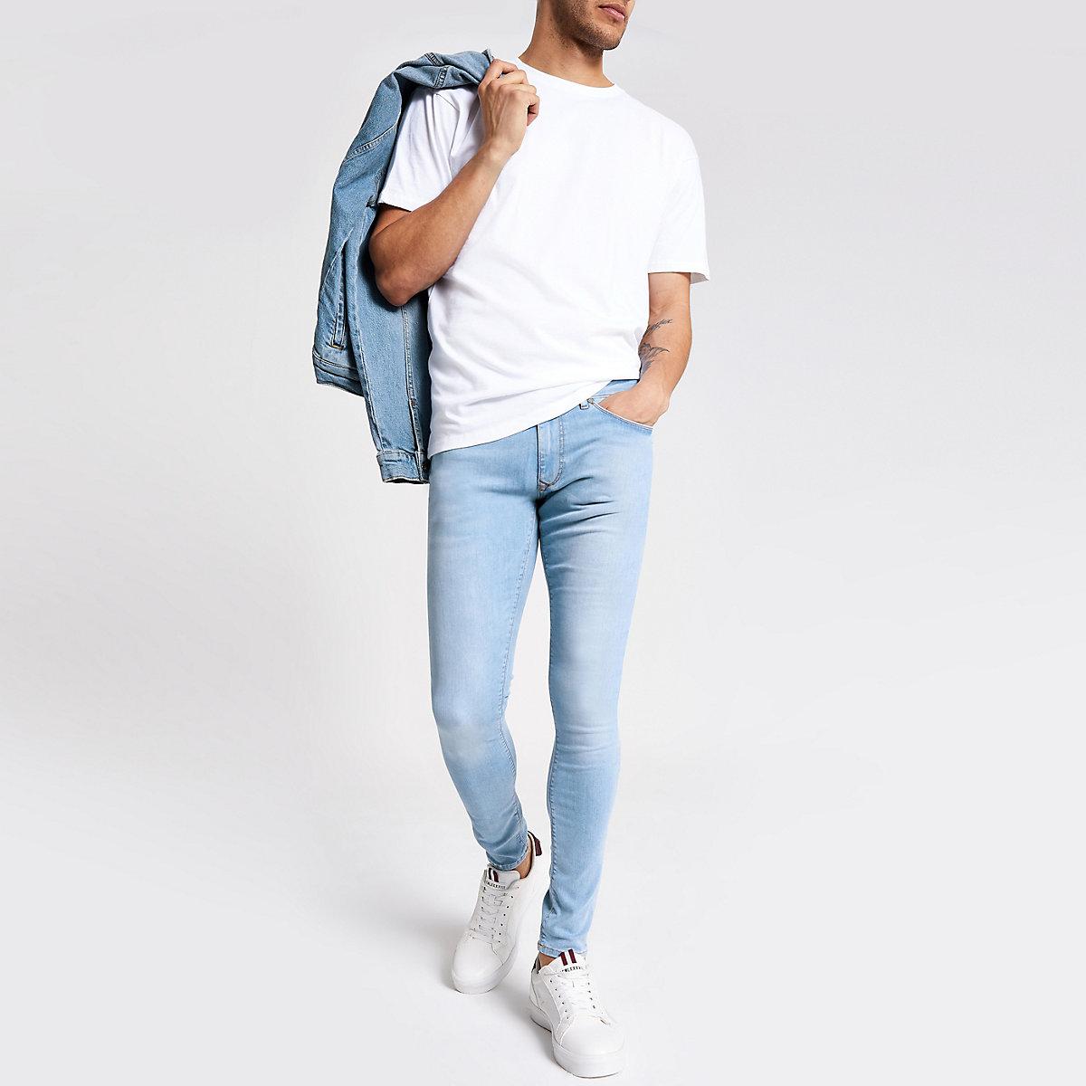 Light blue Ollie spray on faded skinny jeans