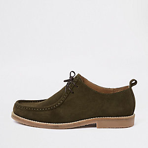 Green suede moccasin shoe