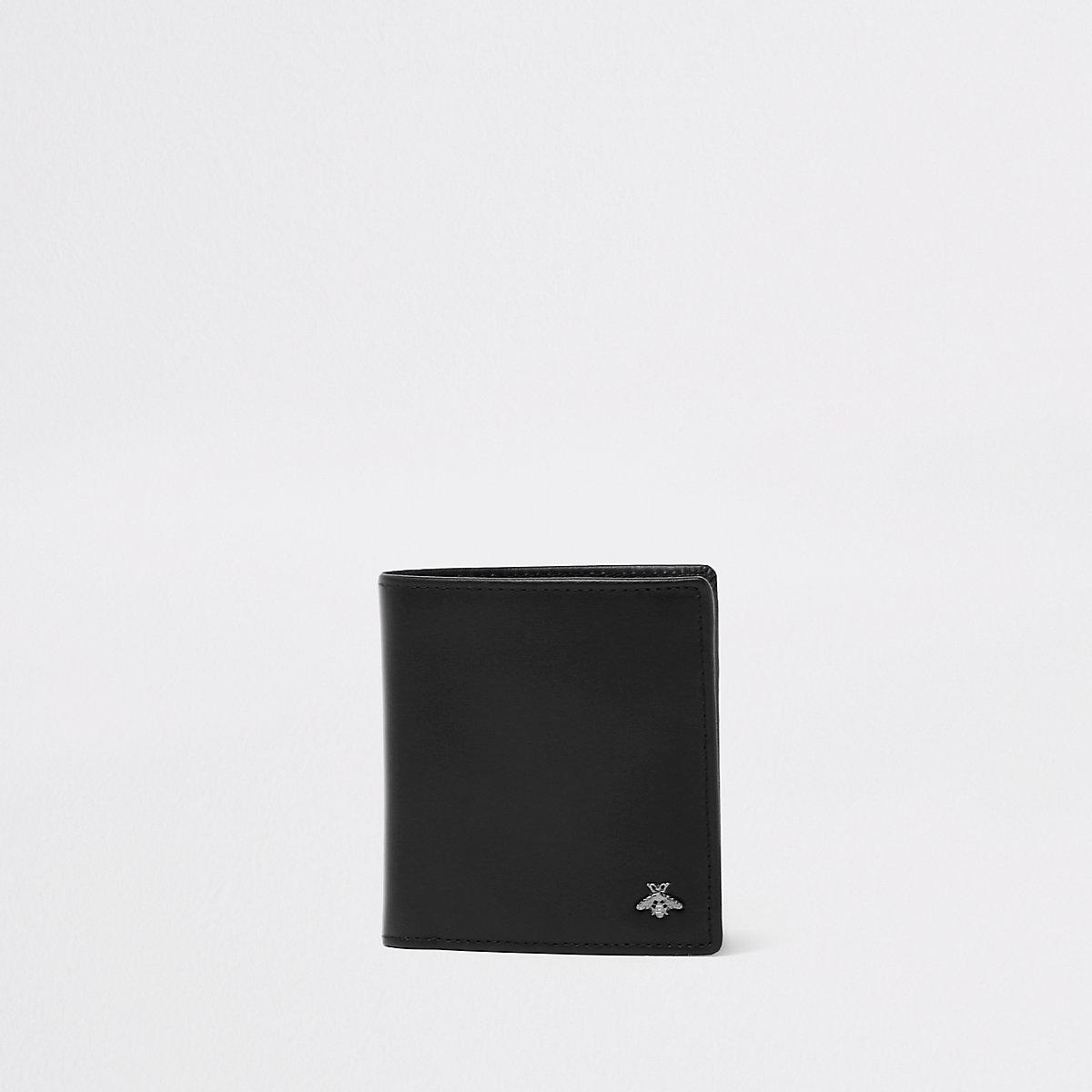 Portefeuille à rabat noir orné d'une guêpe