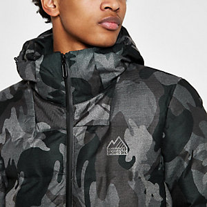 Superdry – Graue Steppjacke mit Camouflage-Muster
