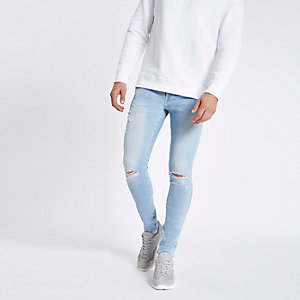 Light blue ripped skinny spray on jeans