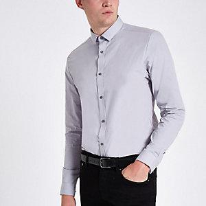 Chemise gris clair boutonnée à manches longues