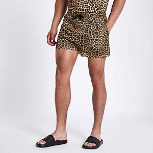 Bruine slim-fit mesh short met luipaardprint