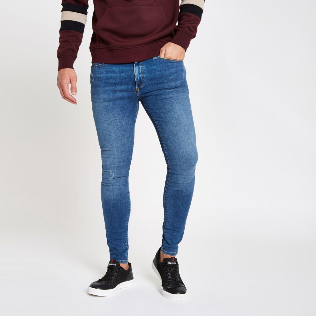 Mid blue Ollie spray on faded skinny jeans