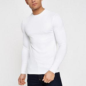 Witte geribbelde top met ronde hals en lange mouwen