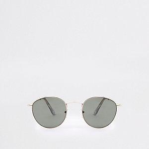 Goudkleurige zonnebril met ronde grijze glazen