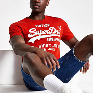 Superdry - Oranje T-shirt met logoprint en ronde hals