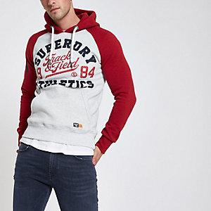 Superdry – Sweat à capuche rouge à manches raglan avec logo vintage