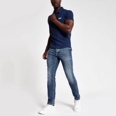 cda5f9f7fb3d 311065 142147 150155 130135 137142. superdry blue logo pique polo shirt.  RIVERISLAND